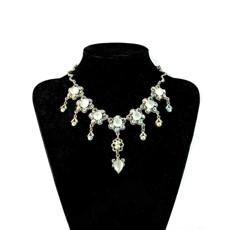 Swarovski kristallen met witte bolletjes sieraad