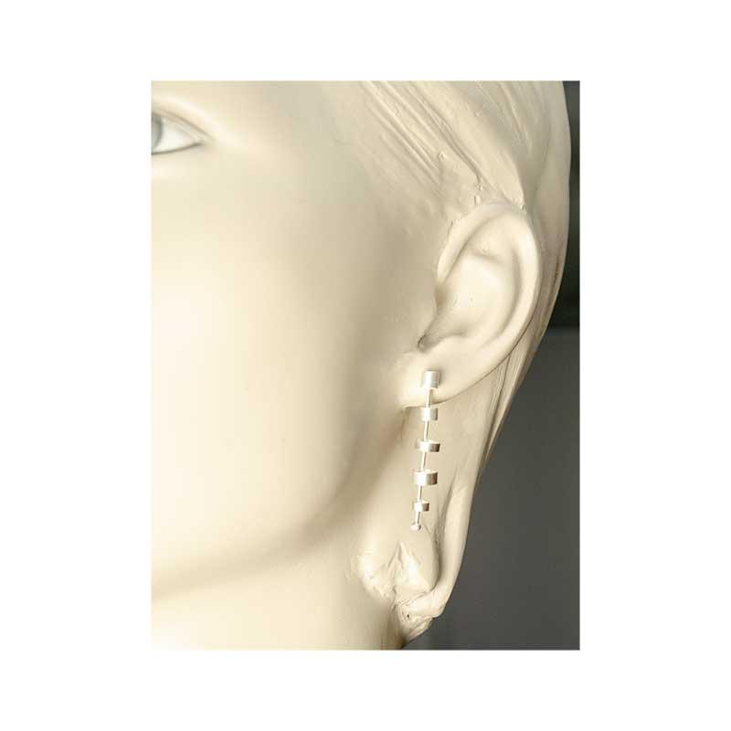 Tubular Sterling Silver Earrings Worn